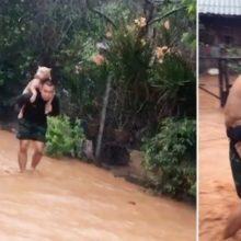 Homem carrega seu cachorro nas costas para salvar a sua vida