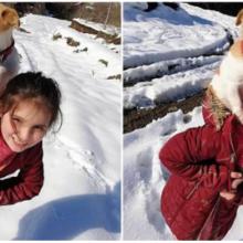 Menina de 8 anos se arrasta com seu cachorrinho doente nas costas na tentativa de salvar sua vida.